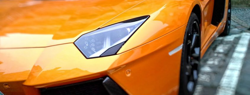 an orange Lamborghini with car coating on the paint