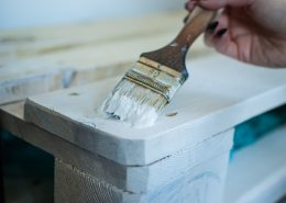 Applying white wood coating on a timber surface